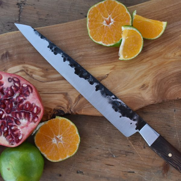 Italy. Handmade in Italy, professional Sujihiki Style Kitchen Knife with stainless steel hammered finish blade and a handcrafted wenge wood handle.